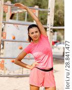 Купить «Woman training on outdoors fitness station», фото № 28841477, снято 26 июня 2018 г. (c) Яков Филимонов / Фотобанк Лори