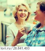Купить «Old women on balcony with coffee», фото № 28841493, снято 20 мая 2014 г. (c) Яков Филимонов / Фотобанк Лори