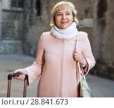 Купить «Cheerful woman with baggage in scarf», фото № 28841673, снято 27 ноября 2017 г. (c) Яков Филимонов / Фотобанк Лори