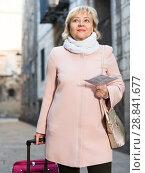 Купить «Mature woman with map and baggage», фото № 28841677, снято 27 ноября 2017 г. (c) Яков Филимонов / Фотобанк Лори