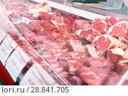 Купить «Meat displayed for sale in shop», фото № 28841705, снято 22 июня 2018 г. (c) Яков Филимонов / Фотобанк Лори