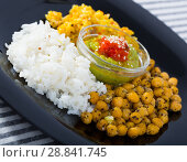 Healthy food of garbanzos and rice with red and green sauces. Стоковое фото, фотограф Яков Филимонов / Фотобанк Лори
