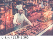 Купить «Man baker showing warm tasty croissant», фото № 28842565, снято 26 января 2017 г. (c) Яков Филимонов / Фотобанк Лори