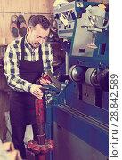 Купить «Male worker repairing shoe», фото № 28842589, снято 2 февраля 2017 г. (c) Яков Филимонов / Фотобанк Лори