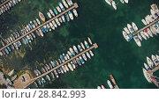 Купить «Aerial view of boats», видеоролик № 28842993, снято 20 июля 2018 г. (c) Илья Шаматура / Фотобанк Лори