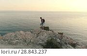 Купить «Hiker with backpack against sea», видеоролик № 28843237, снято 20 июля 2018 г. (c) Илья Шаматура / Фотобанк Лори