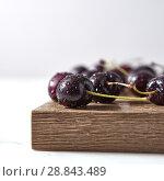 Купить «Home grown fresh cherry with shallow depth of field. Ingredients for sweet homemade jam on a board.», фото № 28843489, снято 12 июня 2018 г. (c) Ярослав Данильченко / Фотобанк Лори