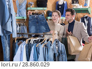 Купить «Young female with male are looking on jeans skirt for her», фото № 28860029, снято 12 марта 2018 г. (c) Яков Филимонов / Фотобанк Лори