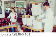 Купить «Man standing in packing section on winemaking factory», фото № 28860161, снято 21 сентября 2016 г. (c) Яков Филимонов / Фотобанк Лори