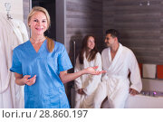 Woman massagist is ready for meet couple in massage cabinet. Стоковое фото, фотограф Яков Филимонов / Фотобанк Лори