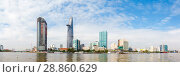 Купить «Skyscrapers business center in Ho Chi Minh City on Vietnam Saigon on background blue sky. view of the business center from the river», фото № 28860629, снято 22 мая 2019 г. (c) Mikhail Starodubov / Фотобанк Лори