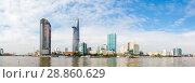 Купить «Skyscrapers business center in Ho Chi Minh City on Vietnam Saigon on background blue sky. view of the business center from the river», фото № 28860629, снято 6 июля 2020 г. (c) Mikhail Starodubov / Фотобанк Лори