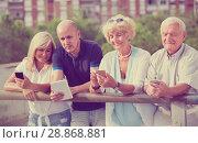 Купить «mature friends chatting in phones», фото № 28868881, снято 24 августа 2017 г. (c) Яков Филимонов / Фотобанк Лори