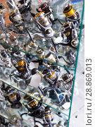 Купить «Image of stand with new nice baitcasting reel», фото № 28869013, снято 16 января 2018 г. (c) Яков Филимонов / Фотобанк Лори