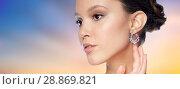 Купить «close up of beautiful woman face with earring», фото № 28869821, снято 9 апреля 2016 г. (c) Syda Productions / Фотобанк Лори