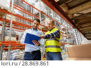 Купить «worker and businessman with clipboard at warehouse», фото № 28869861, снято 9 декабря 2015 г. (c) Syda Productions / Фотобанк Лори