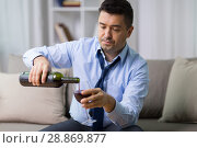 Купить «alcoholic pouring red wine to glass at home», фото № 28869877, снято 24 ноября 2017 г. (c) Syda Productions / Фотобанк Лори