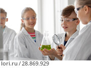 Купить «kids with flask and magnifier at chemistry class», фото № 28869929, снято 19 мая 2018 г. (c) Syda Productions / Фотобанк Лори