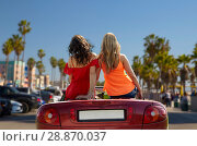 Купить «friends driving in convertible car at venice beach», фото № 28870037, снято 28 мая 2016 г. (c) Syda Productions / Фотобанк Лори