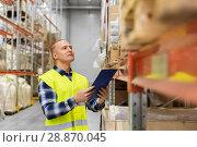 Купить «warehouse worker with clipboard in safety vest», фото № 28870045, снято 9 декабря 2015 г. (c) Syda Productions / Фотобанк Лори