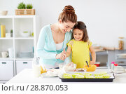 Купить «happy mother and daughter baking muffins at home», фото № 28870053, снято 20 октября 2017 г. (c) Syda Productions / Фотобанк Лори