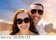 Купить «smiling couple wearing sunglasses making selfie», фото № 28870173, снято 23 июля 2014 г. (c) Syda Productions / Фотобанк Лори