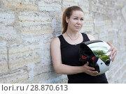 Купить «Female motorcyclist posing with white helmet near stone walls, copy space», фото № 28870613, снято 16 июня 2018 г. (c) Кекяляйнен Андрей / Фотобанк Лори