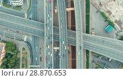 Купить «Aerial top view of road junction in Moscow from above, automobile traffic and jam of many cars, transportation concept», видеоролик № 28870653, снято 30 июля 2018 г. (c) Mikhail Starodubov / Фотобанк Лори