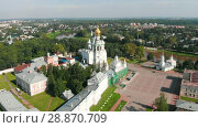 Купить «Flight of the camera over Saint Sophia orthodox cathedral and church of Resurrection of Jesus in a sunny summer day in Vologda Kremlin», видеоролик № 28870709, снято 30 июля 2018 г. (c) Mikhail Starodubov / Фотобанк Лори