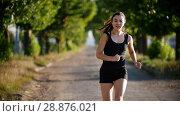 Купить «Sporty Young Woman Running In The Park», видеоролик № 28876021, снято 15 октября 2019 г. (c) Константин Шишкин / Фотобанк Лори