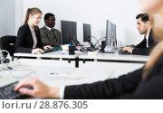 Купить «Group of adult business people during daily work», фото № 28876305, снято 24 марта 2018 г. (c) Яков Филимонов / Фотобанк Лори