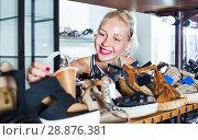 Купить «Glad woman shopping pair of new shoes», фото № 28876381, снято 21 сентября 2018 г. (c) Яков Филимонов / Фотобанк Лори