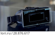 Купить «vr headset with coding and counting numerals», видеоролик № 28876617, снято 21 января 2019 г. (c) Syda Productions / Фотобанк Лори