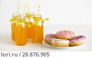 Купить «donuts and lemonade or juice in glass bottles», видеоролик № 28876905, снято 13 июля 2018 г. (c) Syda Productions / Фотобанк Лори