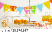 Купить «food and drinks on table at birthday party», видеоролик № 28876917, снято 13 июля 2018 г. (c) Syda Productions / Фотобанк Лори