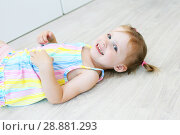 Купить «Cheerful cute little girl lying on the floor in the children's room», фото № 28881293, снято 23 июля 2018 г. (c) ivolodina / Фотобанк Лори