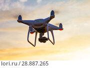 Купить «Professional drone quad copter with digital camera at sunset ready to fly for surveillance. close-up of Rotor UAV. four blade propeller drone. silhouette copter on beautiful sunset.», фото № 28887265, снято 22 июля 2018 г. (c) Алексей Ширманов / Фотобанк Лори