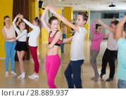 Купить «Teenagers in pairs learning active boogie-woogie», фото № 28889937, снято 3 марта 2018 г. (c) Яков Филимонов / Фотобанк Лори