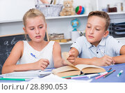 Купить «Brother with sister are doing homework», фото № 28890053, снято 23 августа 2019 г. (c) Яков Филимонов / Фотобанк Лори