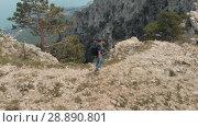 Купить «Man is traveling in the mountains», видеоролик № 28890801, снято 19 июля 2018 г. (c) Илья Шаматура / Фотобанк Лори