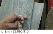 Купить «Nepalese craftsman working on traditional Mani slate stone in Kathmandu, Nepal», видеоролик № 28890813, снято 18 июня 2018 г. (c) Dzmitry Astapkovich / Фотобанк Лори