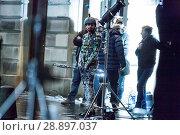 Купить «Film crew and stuntmen prepare for the filming of the upcoming movie 'Avengers: Infinity War' on the Royal Mile in Edinburgh Featuring: Stuntman Where...», фото № 28897037, снято 31 марта 2017 г. (c) age Fotostock / Фотобанк Лори