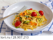Купить «Homemade pasta with strips of zucchini and carrots», фото № 28907213, снято 7 августа 2018 г. (c) Марина Сапрунова / Фотобанк Лори