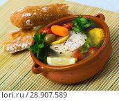 Купить «Fisherman's soup cooked with boiled pollock, carrots, corn and greens», фото № 28907589, снято 7 июля 2020 г. (c) Яков Филимонов / Фотобанк Лори