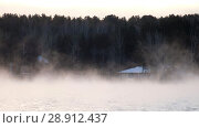 Купить «Vapor over water of Ob Sea in winter season in Siberia Houses and forest on the bank of river.», видеоролик № 28912437, снято 18 декабря 2017 г. (c) Serg Zastavkin / Фотобанк Лори