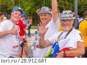 Купить «Russia, Samara, June 2018: benevolent mature football fans in original hats with national flags at the World Cup.», фото № 28912681, снято 21 июня 2018 г. (c) Акиньшин Владимир / Фотобанк Лори