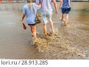 Купить «Russia, Samara, June 2018: A pedestrian crosses the road through deep water after a heavy rainfall.», фото № 28913285, снято 21 июля 2018 г. (c) Акиньшин Владимир / Фотобанк Лори
