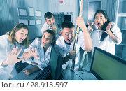 Купить «Guys and girls having fun in escape room», фото № 28913597, снято 6 июля 2017 г. (c) Яков Филимонов / Фотобанк Лори