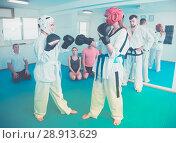 Купить «Women practicing at taekwondo class», фото № 28913629, снято 8 апреля 2017 г. (c) Яков Филимонов / Фотобанк Лори