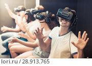 Купить «Excited man experiencing with friends virtual reality», фото № 28913765, снято 6 июля 2017 г. (c) Яков Филимонов / Фотобанк Лори